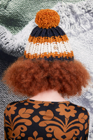 Navy and ochre wool pom pom hat  image