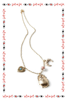 Necklace with eastern inspired charms and a scarab image