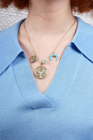 Necklace with eastern inspired charms and medallion image
