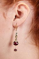 Garnet drop earrings with mismatched motifs  image